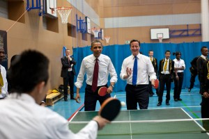 President Barack Obama and British Prime Minister David Cameron in a game of ping-pong.