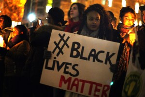 A person holding up a Black Lives Matter sign at a protest.
