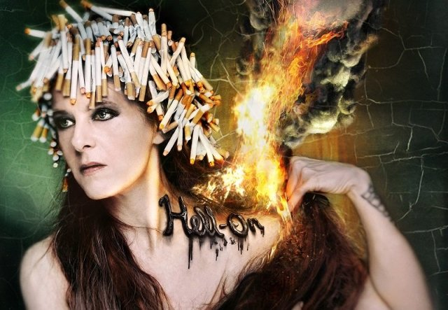 Album art for Neko Case's hell-on, featuring the artist wearing a wig made of cigarettes