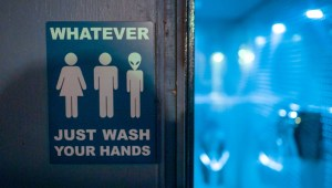 A bathroom sign inviting people of all genders to use the restroom