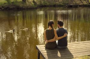 Two people on a dock