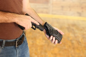 A person demonstrating a conceal carry holster