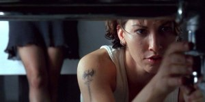 A still from bound, featuring a character fixing a sink.