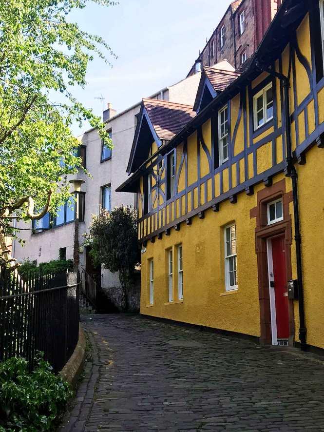 old yellow row homes in dean village edinburgh