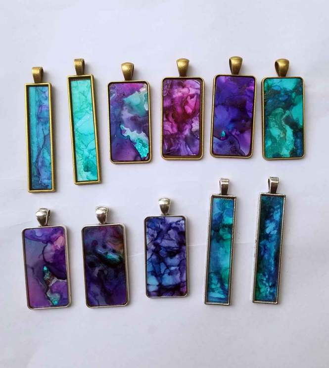 Travel the world with Free Verse Designs resin necklaces