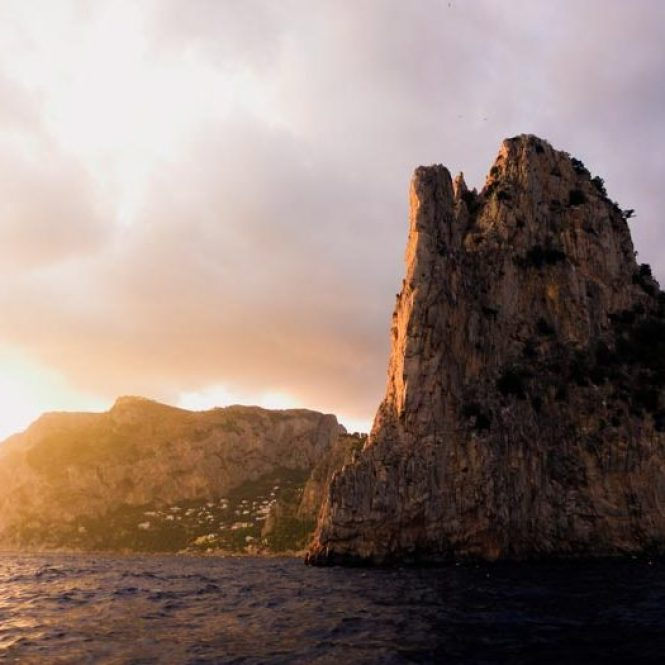 Sun setting on the coastline of Italy's island of Capri.