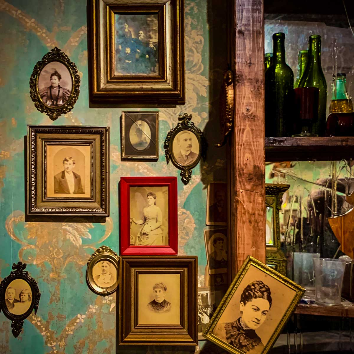 Framed portraits near the bar in the American Prohibition Museum