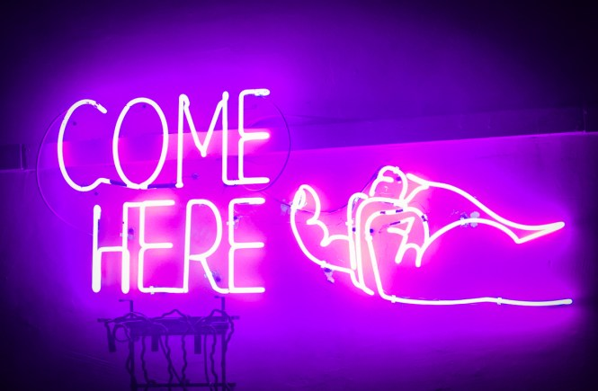 """Come here"" neon sign"