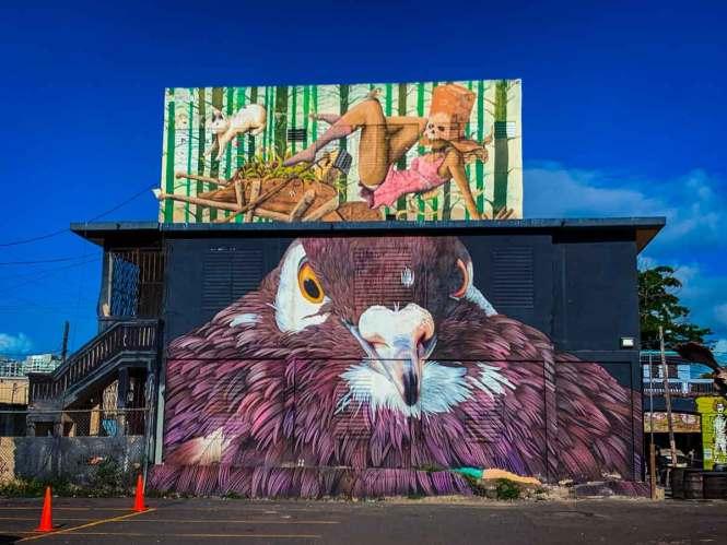 """the fall"" mural over a big bird mural"