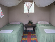 Cottage bedrooms at Tania's Guesthouse. Mosquito nets included!