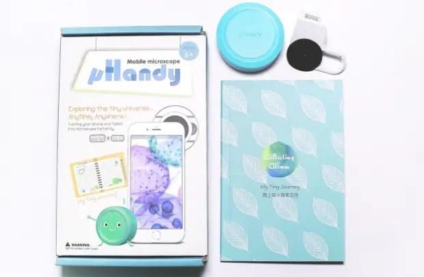 小型顕微鏡デバイス「μHandy」本体1台、特殊シール108枚、サンプル付き学習用ノート教材1冊がセットになっている。