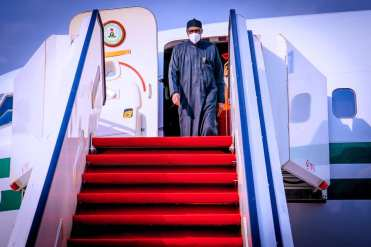 President Buhari stepping of the presidential aircraft