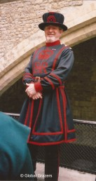This cheery beefeater stands guard at the Tower of London. London, England