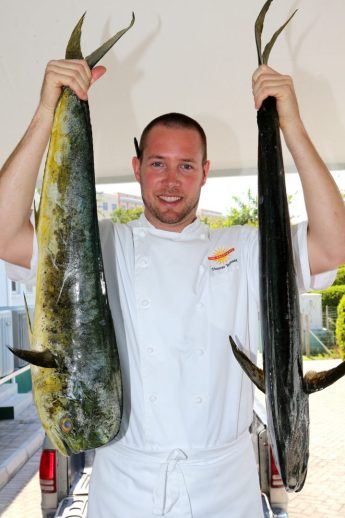 Chef Tyler Tennent holding Wahoo at The Brasserie