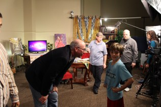 Steve chats with a small visitor to the set