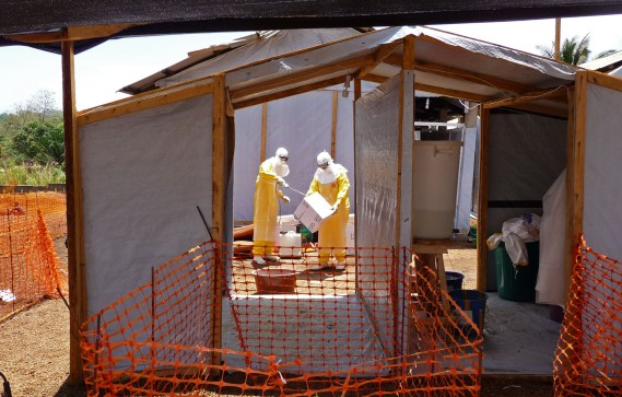 Healthcare workers from Medecins Sans Frontieres prepare isolation and treatment areas for their Ebola, hemorrhagic fever operations, in Gueckedou, Guinea on March 28, 2014,  (AP Photo/Kjell Gunnar Beraas, MSF)