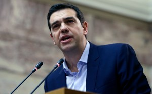 Greece's Prime Minister Alexis Tsipras delivers a speech in Athens, Feb. 17, 2015. (AP Photo/Thanassis Stavrakis)