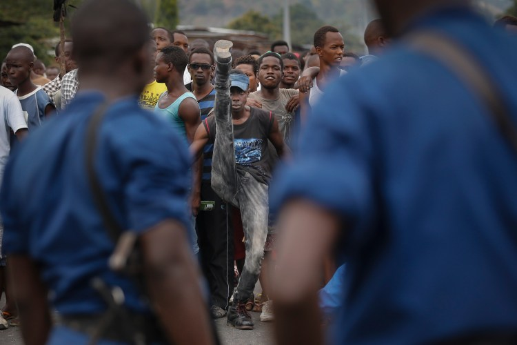 A Burundian protester raises his leg as he and others face off with police officers, during an anti-government demonstration in Bujumbura, May 20, 2015. EPA/Dai Kurokawa