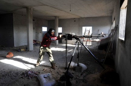 A militia man fighting against the Islamic State near the city of Benghazi, March 10, 2016. (AP Photo/Mohammed El-Shaiky)