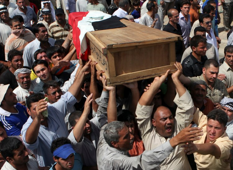 Iraq is among the most dangerous countries in the world for journalists. Above, the coffin of Iraqi journalist Riyadh Al-Sarai during his funeral procession in Baghdad, Sept. 7, 2010. Unknown gunmen in a speedy car intercepted the car of al-Sarai in Harithiya area of Baghdad and killed him by silenced pistols. (AP Photo/Khalid Mohammed)