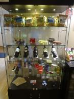 A variety of wines, beer, crisps (potato chips), choclates and snacks for sale
