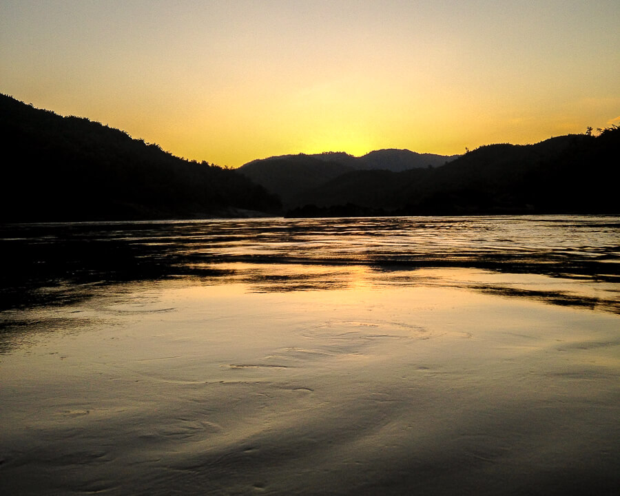 sunset on mekong river laos