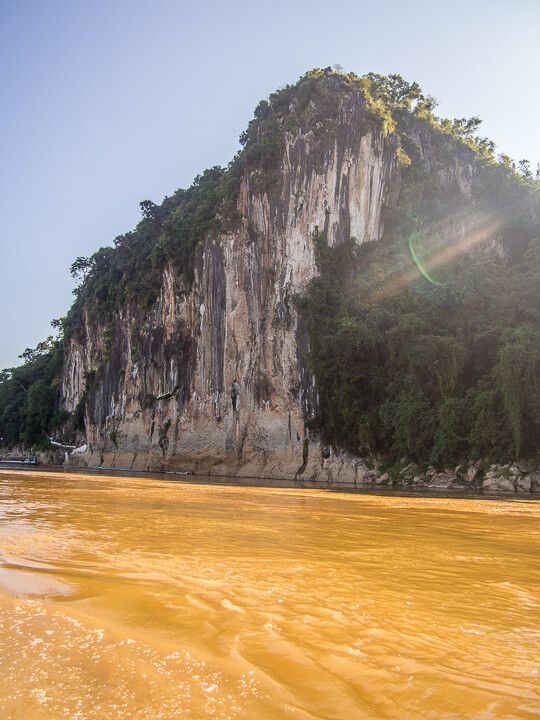 muddy turbulent waters of mekong river laos