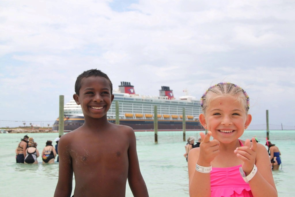 Multi Racial Family in front of Disney Cruise Ship