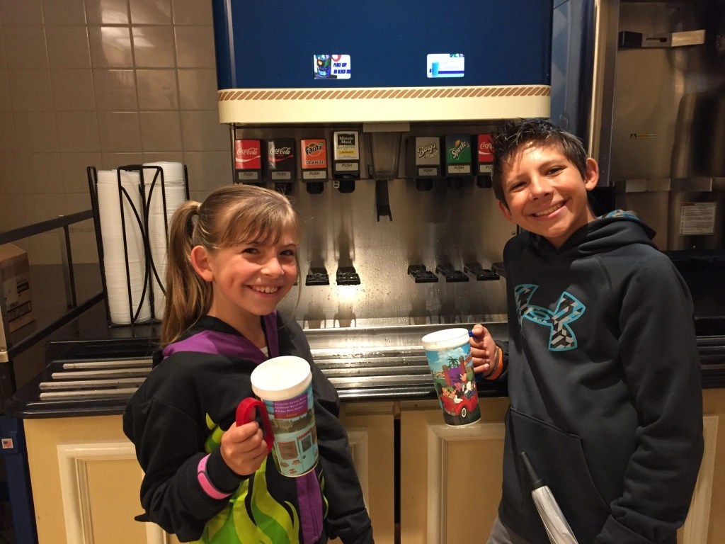 Kids with their Refillable Mugs Disney Resort | Global Munchkins