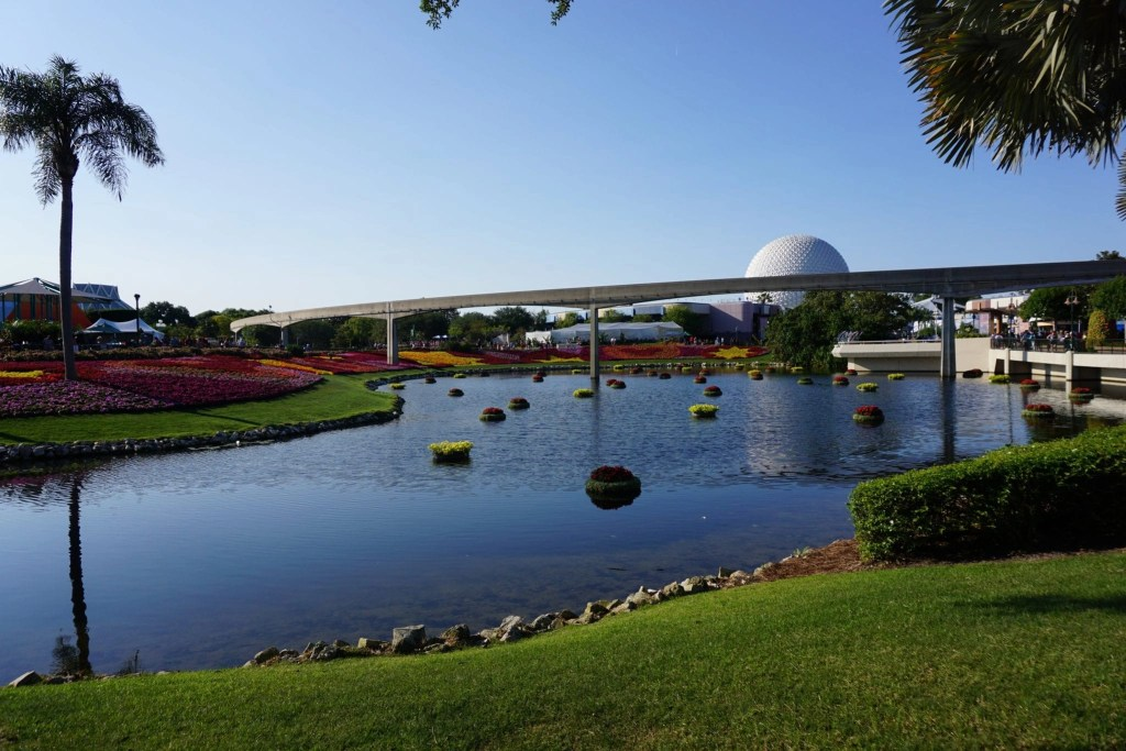 Gorgeous image overlooking the lake at Epcot with Ball in Background | Global Munchkins