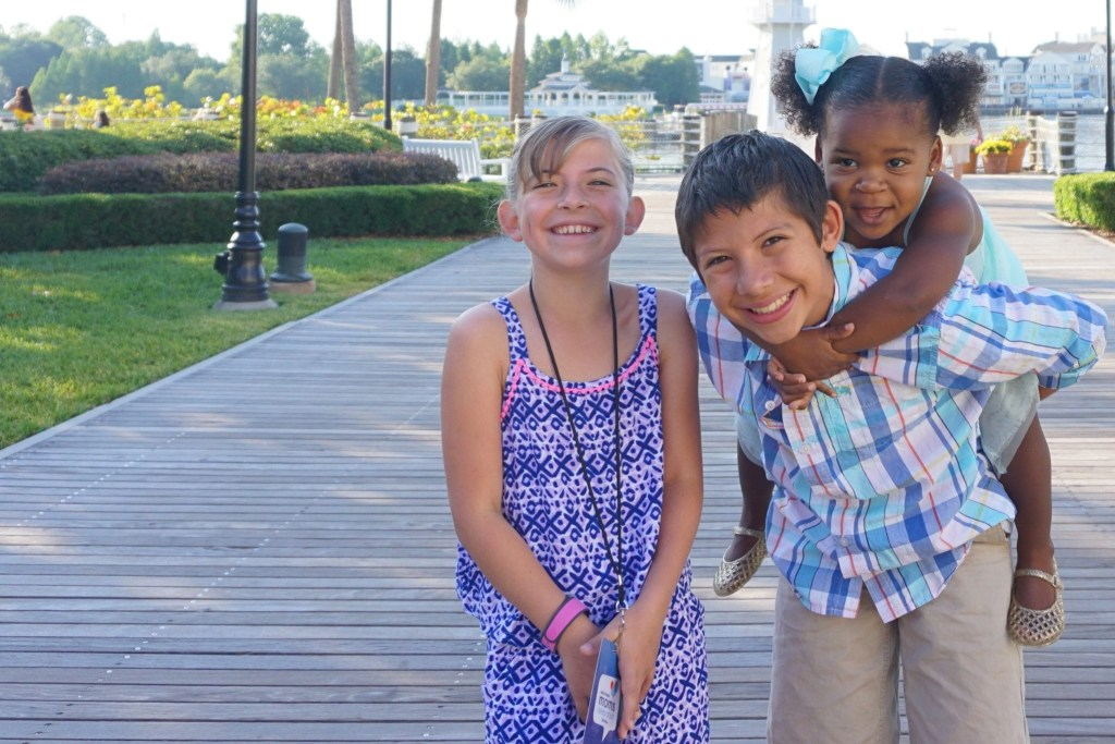 Happy Transracial Adoptive Family on boardwalk at Beach Club Resort | Global Munchkins
