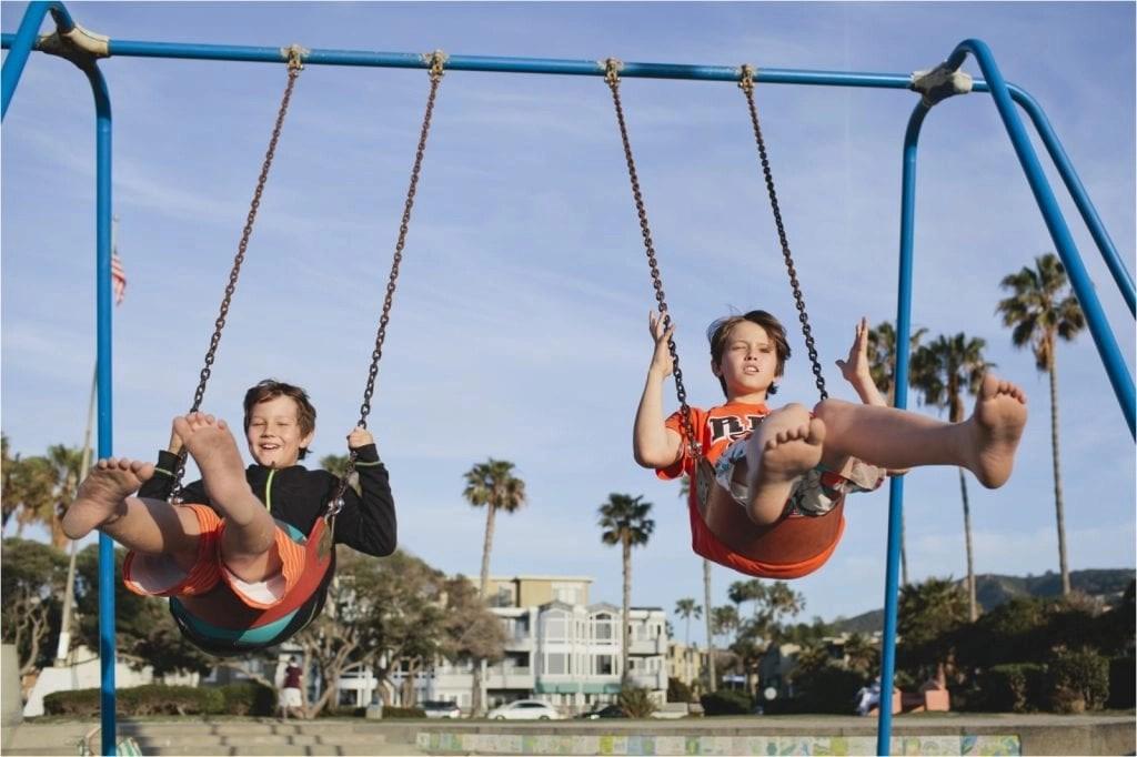 Boys swinging on beach in La Jolla CA THE LEO LOVES San Diego Lifestyle Family Photographer Erin Oveis Brant