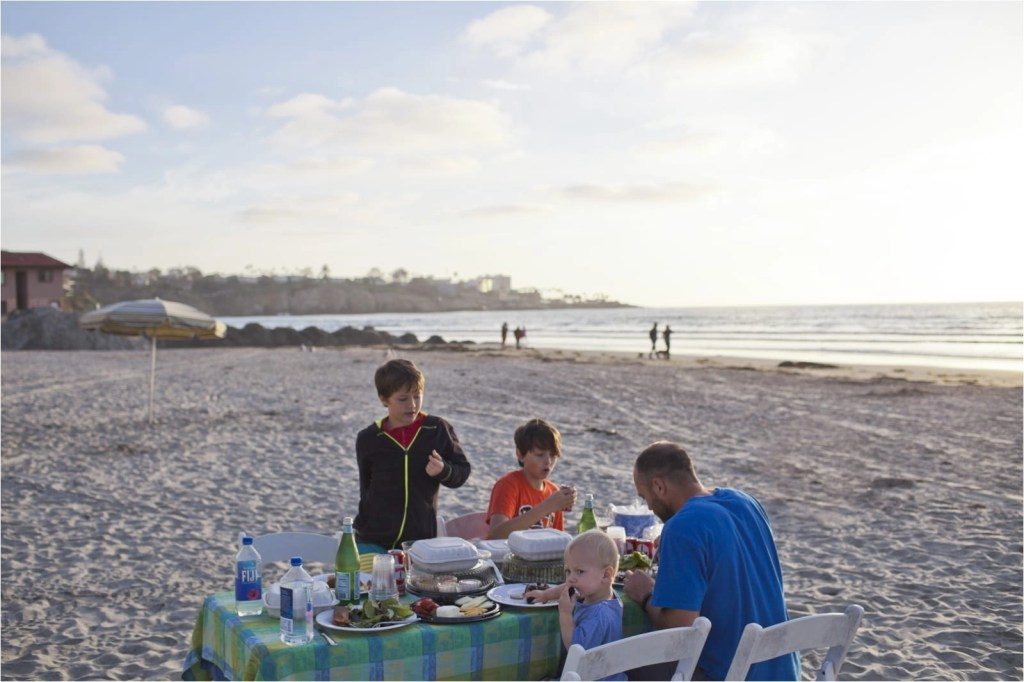 Beach picnic, family eating on the beach provided by La Jolla Shores Hotel restaurant THE LEO LOVES San Diego Lifestyle Family Photographer Erin Oveis Brant