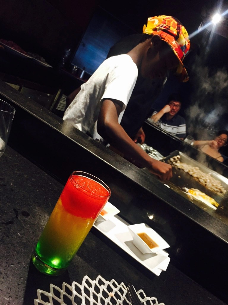 My son getting lessons behind the counter from our Teppan chef at the Hard Rock Cancun