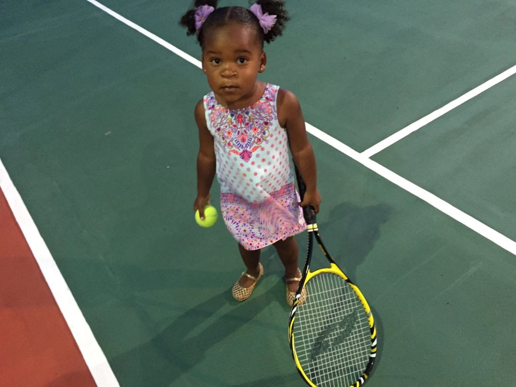 Little black girl Playing tennis at the Hard Rock Cancun