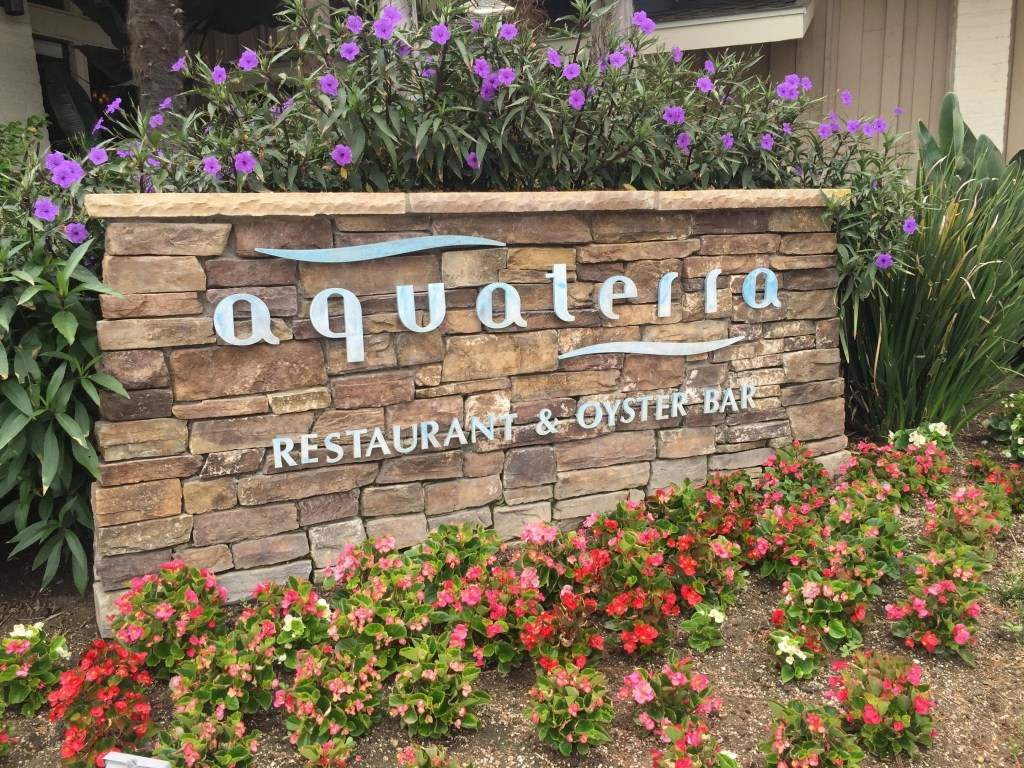 Beautiful stone sign for the Aquaterra restaurant at Pala Mesa Golf Course in Fallbrook CA | Global Munchkins
