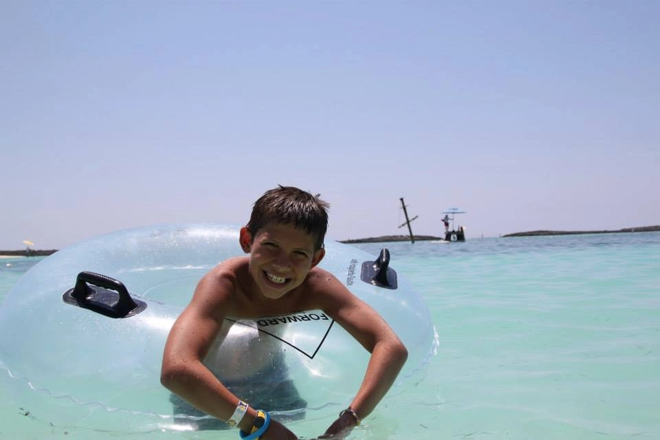 boy in tube in water at Castaway Cay Disney Cruise Line's Private Island   Global Munchkins