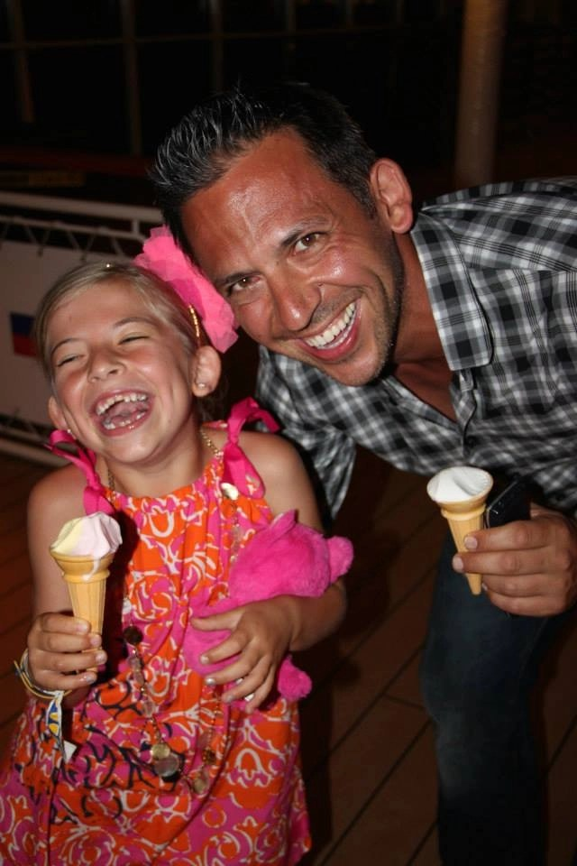 Father and Daughter laughing and eating ice cream on Disney Cruise Line- Global Munchkins