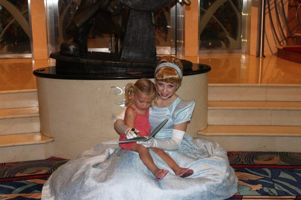 Little girl taking picture with Cinderella on board Disney Cruise Line | Global Munchkins