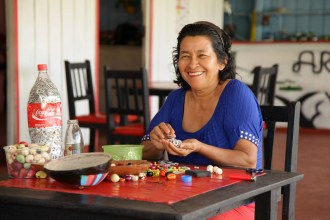 Brazilian artisan who is part of Coca-Cola's 5by20 initiative.