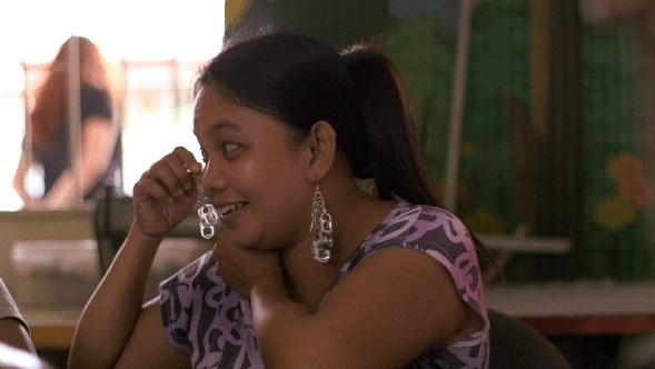 Artisan in the Philippines modeling Coca-Cola's 5by20 earrings they create there.