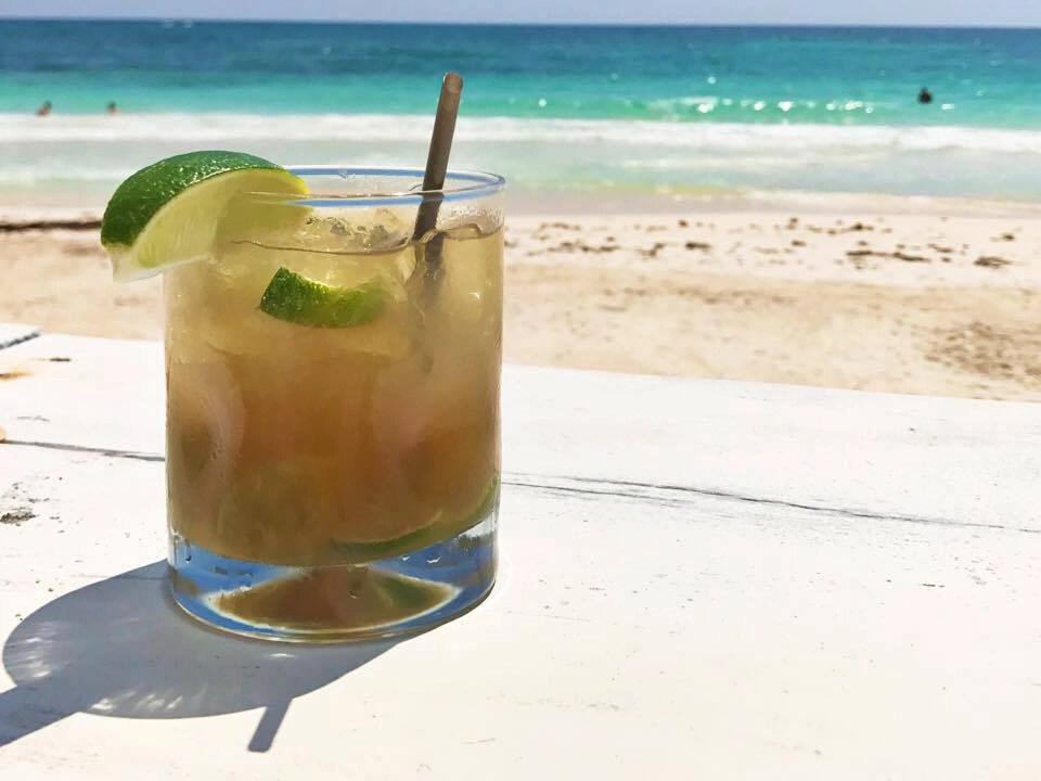 Drink on a Tulum Beach at eco-chic Coco Tulum resort.