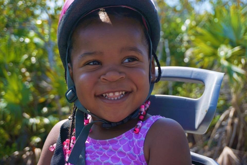 She's smiling because her parents know the secret to planning the best summer vacation. Want to know what it is? Click to find out. Tips on avoiding these 5 common mistakes when traveling with kids