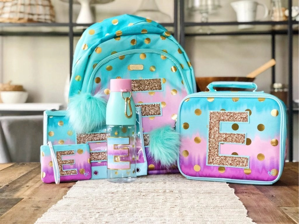 #AD Personalized backpack, lunch box and more. Check out these super adorable and very trendy girls backpacks from Justice. They have everything you need for back to school including personalized backpacks, lunch boxes and more. #tween #backtoschool