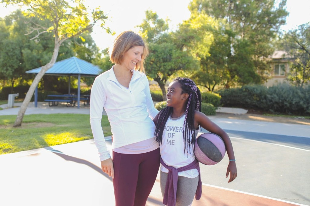 Teaching girls to stay in the game is so important. Learn from a coach + mom of 4 on how she is encouraging her daughters to stay in the game. All outfits by Athleta. #sponsored