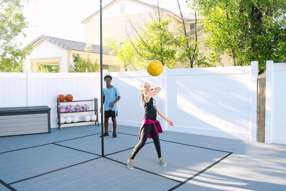 Our Backyard Court from Sport Court is a Multi-Game Court that includes Basketball, Badminton, Pickleball, Volleyball, Tetherball, and Four Square. It's incredibly versatile.