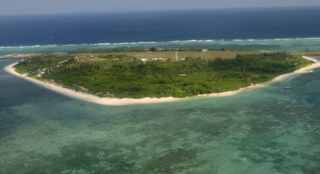 This July 20, 2011 file aerial photo, taken through the window of a closed aircraft, shows Pag-asa Island, part of the disputed Spratly group of islands, in the South China Sea located off the coast of western Philippines.  Philippine President Rodrigo Duterte said Thursday, April 6, 2017, that structures should be built on all of the nine to 10 islands, reefs and shoals held by the Philippines in the Spratly Islands.  Duterte said he may visit one of the islands, Pag-asa, to plant a Philippine flag on Independence Day. He said money has been budgeted to repair the runway on Pag-asa, home to a small fishing community and Filipino troops.   (AP Photo/Rolex Dela Pena, Pool, File)