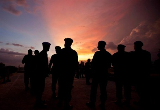 FILE – This Monday, July 11, 2011, file photo shows silhouettes of UN peacekeepers from Brazil at the airport in Port-au-Prince, Haiti. (AP Photo/Eduardo Verdugo)