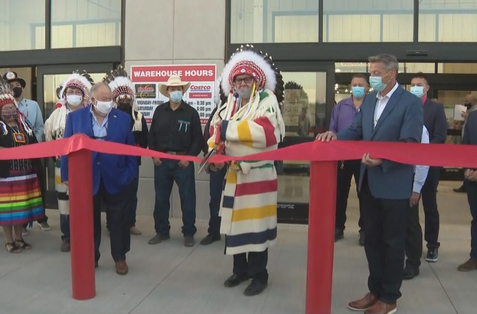 Tsuut'ina chef Roy Whitney cuts a ribbon at the grand opening of the Southwest Calgary Costco located in the shops of Buffalo Run.