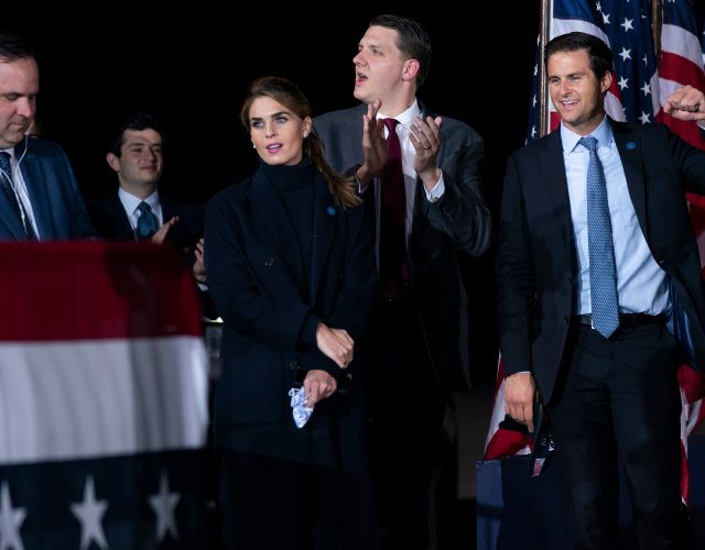 From left, White House director of social media Dan Scavino, Counselor to the President Hope Hicks, special assistant to the President and White House trip director William Russell, and director of the White House personnel John McEntee listen as President Donald Trump speaks during a campaign rally at Harrisburg International Airport, Saturday, Sept. 26, 2020, in Middletown, Pa.